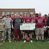 Justyn Curtis of Richmond, Indiana, center, was awarded an Army ROTC scholarship for $20,400 Saturday after the Chadron State Spring Game. From left, Lt. Col. Lynna Speier, professor of Military Science and Leadership with the Mount Rushmore Battalion, Sgt. Carl Dehling, Jay Long, head football coach, Kurt Curtis, Justyn's father, and Dr. Randy Rhine, president of CSC. Curtis will be commissioned as a second lieutenant when he graduates from CSC. (Tena L. Cook/Chadron State College)