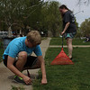 Chadron State College students Lane Swedberg of North Platte, Neb., and Abigail Cary of Gothenburg, Neb., clean the Chadron Public Library's front lawn as part of The Big Event April 23, 2016. (Photo by Conor Casey/CSC)
