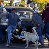 Bystanders of Chadron State College's 2016 Homecoming Parade help push an historic police car with temporary engine problems down Main Street. (Photo by Conor Casey/CSC)