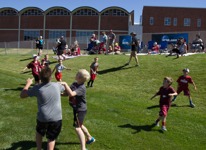 Kids participate in a pick up football game during the Family Day football game at Don Beebe Stadium, Sept. 17 2016. (Photo by Conor Casey/CSC)