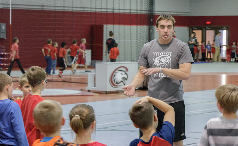 Cory Martens of Newton, Kansas, explains an activity to kids participating in Jump Rope for Heart in the Nelson Physical Activities Center. (Photo by Conor Casey/CSC)