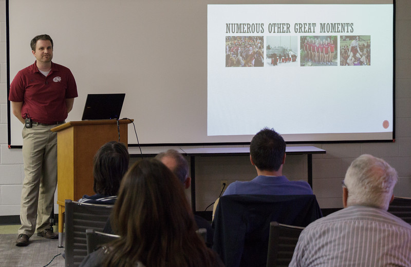 """Alex Helmbrecht, Chadron State director of College Relations, presents """"Behind the Polo Shirt"""" to a crowd of attendees in the Reta King Library, as part of the Graves Lecture Series. (Photo by Conor Casey/CSC)"""