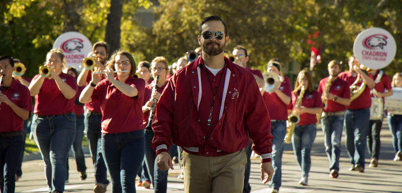 Sidney Shuler, music professor at Chadron State, leads the CSC band down Main Street as part of the 2016 Homecoming Parade, Oct. 8, 2016. (Photo by Conor Casey/CSC)