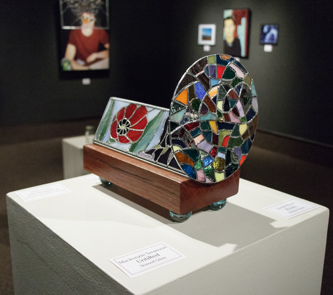 """Mackenzie Swanson's stained glass piece """"Kaleidoscope"""" is on display in the Memorial Hall Main Gallery, as part of the Senior Art Exhibition.  (Photo by Conor Casey/CSC)"""