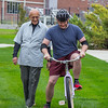 Dr. Marv Neuharth, CSC education faculty member, left, helps Shawn Myers of Chadron, Nebraska, find his bearings on a reverse steering bicycle. (Photo by Conor Casey/CSC)
