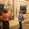 Sarah Polak, director of the Mari Sandoz Museum, left, guides a tour through the Mari Sandoz Center for national travel writers, as part of a tour of Western Nebraska sponsored by the Nebraska Tourism Commission, Sept. 29, 2016. Pictured are Susan Blower of Anderson, Indiana, who contributes to Antique Week and Patrick T. Cooper of Atlanta, Georgia, a columnist for the Global Traveler. (Photo by Conor Casey/CSC)