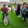 Danny Guelzow of Denver, Colorado, attempts to ride a reverse steering bicycle as part of of a psychology class instructed by Chadron State College education faculty member Dr. Marv Neuharth, Sept. 21, 2016.  (Photo by Conor Casey/CSC)