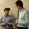Chadron State College graduate student Daler Abzhabarov of Tajikistan, left, speaks with CSC business faculty member Chris McCarthy following McCarthy's Graves Lecture Series Tuesday, Sept. 27, 2016. (Photo by Tena L. Cook/Chadron State College)