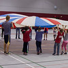 Elementary students participating in the Kids Fitness and Nutrition Day in the Nelson Physical Activities Center play games with a parachute, Oct. 25, 2016. (Photo by Conor Casey/CSC)