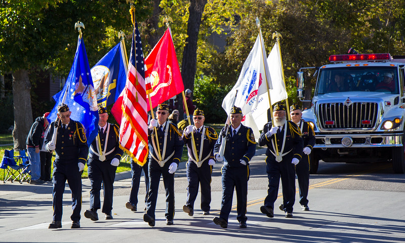 The military Color Guard leads the Chadron State College 2016 Homecoming parade. (Photo by Conor Casey/CSC)