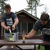 Chadron State College football team members Jared Maciejczak of Rapid City, S.D., left, and Tanner Wintholz of Sidney, Neb., paint picnic tables at Chadron State Park April 23, 2016, during The Big Event. (Tena L. Cook/Chadron State College)