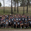 The Chadron State College football team poses with family members and Chadron State Park personnel and volunteers April 23, 2016, before planting 800 trees in the park. (Tena L. Cook/Chadron State College)