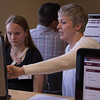 Tindra Norris, left, of Mead, Colorado, works through her fall course schedule with guidance from Dr. Tracy Nobiling during the June 17, 2016 Signing Day. (Photo by Tena L. Cook/Chadron State College)