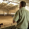 Participants in the Rural Futures Initiatives Forum listen to a Chadron State College rodeo team member explain the benefits of the Coffee Agriculture Pavilion Wednesday, Sept. 28, 2016. (Photo by Tena L. Cook/Chadron State College)