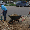 Dr. Tracy Nobiling, associate professor of justice studies, and Dr. Jamie Wada, associate professor and department chair of justice studies, help spread mulch at the Dawes County Courthouse as part of The Big Event, April 23, 2016. (Photo by Conor Casey/CSC)