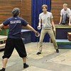 """Doug Valade, Nathan Wojciechowski and Craig Phillips practice a sword fighting scene from """"No Holds Bard"""" in the Burkhiser Complex. (Photo by Conor Casey/CSC)"""