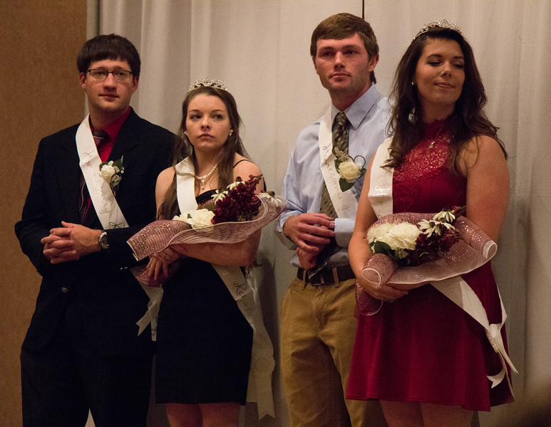 Chadron State College royalty court attendants stand as they are announced in the Student Center ballroom, Oct. 5, 2016. From left, Curtis Stevens of St. Paul, Nebraska. Whitney Coop of  Columbus, Neb., Garrett Dockweiler of Oconto, Neb.; Chelsea Haynes of Auburn, Neb. (Photo by Conor Casey/CSC)