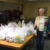 Pastor Ann Sundberg of the Immanuel Lutheran Church, left, and CSC CA239 student and publicity chair Brittany Province pose with more than 300 food items donated to the church's food pantry at the Oxfam Hunger Banquets Monday night. (Courtesy photo)