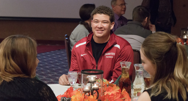 Palmer White of Denver, Colorado, dines at the high-income tables as part of the Oxfam Hunger Banquet in the Student Center Ballroom. (Photo by Conor Casey/CSC)