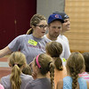 Andee Grentz of Mitchell, Nebraska, explains a game to elementary kids at Kids Fitness and Nutrition Day in the Nelson Physical Activities Center. (Photo by Conor Casey/CSC)