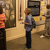 Sarah Polak, director of the Mari Sandoz Museum, guides a tour through the Mari Sandoz Center for national travel writers, as part of a tour of Western Nebraska sponsored by the Nebraska Tourism Commission, Sept. 29, 2016. Pictured are Susan Blower of Anderson, Ind. who contributes to Antique Week and Patrick T Cooper of Atlanta, Ga., a columnist for the Global Traveler. (Photo by Conor Casey/CSC)
