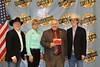 Chadron State College's Vice President of Enrollment, Marketing and Student Services, Jon Hansen, third from left, accepts the Merit Award on behalf of the CSC rodeo team from representatives of the Central States Fair and Black Hills Stock Show. (Courtesy Photo)