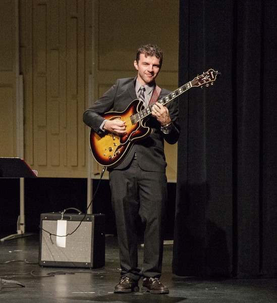McKay Tebbs, music professor at Chadron State College, performs a solo during the Keyboard and Guitar Ensemble in the Memorial Hall Auditorium, Dec. 3, 2016. (Photo by Conor Casey/CSC)
