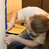 Jennifer Scherbarth of Hay Springs, Neb., tapes a doorway she's preparing to paint at the Dawes County Historical Society Museum Saturday as part of the fourth annual Chadron State College The Big Event. (Tena L. Cook/Chadron State College)