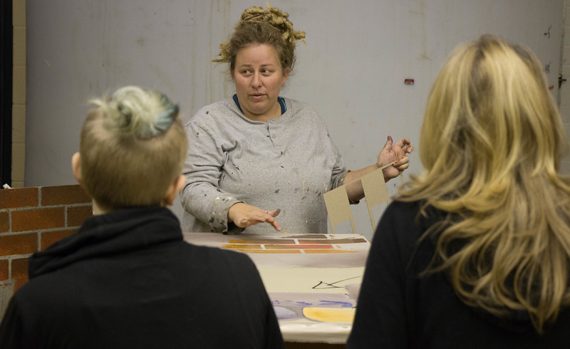 Amy Campion, Chadron State College alumna, guides attendees of CSC's annual Theatre Day Oct. 6, 2016, in the art of scene painting in the Burkhiser set shop. (Photo by Conor Casey/CSC)