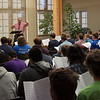 Dr. Joel Schreuder, Chadron State College music faculty member, leads high school vocalists who took part in Men's Choir Day in the Mari Sandoz Center's Chicoine Atrium Oct. 20, 2016.  (Photo by Conor Casey/Chadron State College)