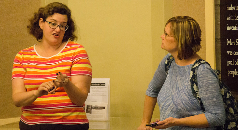Sarah Polak, director of the Mari Sandoz museum, left, explains Sandoz's family background as travel writer Susan Blower of Anderson, Ind. records and listens in the Mari Sandoz Center, Sept. 29, 2016. (Photo by Conor Casey/CSC)