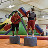 Students try out the inflatables during Spring Daze Saturday in Armstrong Gym. (Photo by Tena L. Cook/Chadron State College)
