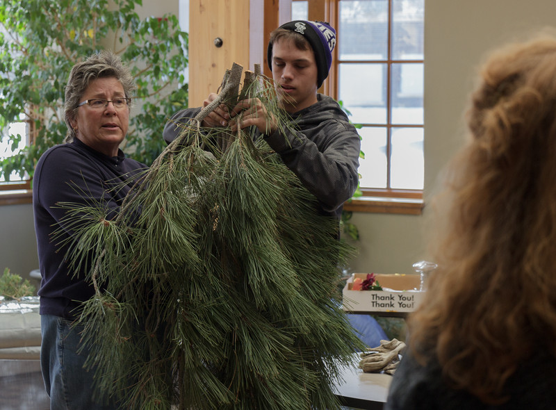 Lucinda Mays, CSC grounds supervisor, instructs a workshop on making holiday swags in the Mari Sandoz Chicoine Atrium, Nov. 19, 2016. (Photo by Conor Casey/CSC)
