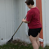 Danielle Kuxhausen of Scottsbluff rakes leaves at the Dawes County Historical Society Museum April 23, 2016, during the fourth annual The Big Event. (Tena L. Cook/Chadron State College)