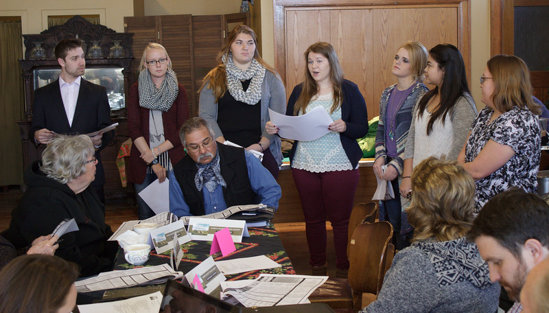 Chadron State College students enrolled in Relational and Family Communication (CA 450) present their trail map and guide of Northwest Nebraska to the Dawes County Travel Board at the Bean Broker, Dec. 6, 2016. (Photo by Conor Casey/CSC)