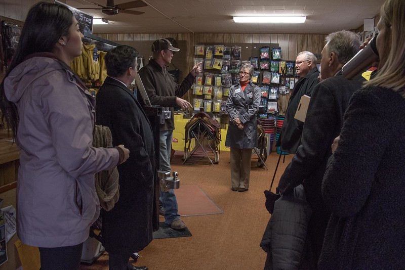 """Cody Brooks, owner of White River Feed, center, speaks with representatives of the Nebraska Business Development Center in Chadron and Omaha and the University of Omaha Tuesday, Nov. 29, 2016, during a """"Get to Know You"""" NBDC tour of client businesses. (Photo by Tena L. Cook/Chadron State College)"""