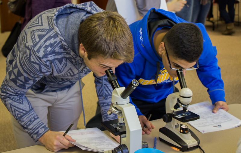 Area high school students learn the specifics of microscopes at the Health Professions Showcase in the Student Center, Oct. 20, 2016.  (Photo by Conor Casey/Chadron State College)
