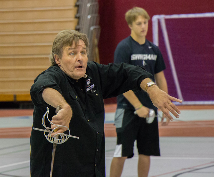 Roger Mays, professor of Theatre at Chadron State College, instructs participants of Theatre Day in combat with rapiers in the Nelson Physical Activity Center, Oct. 6 2016. (Photo by Conor Casey/CSC)