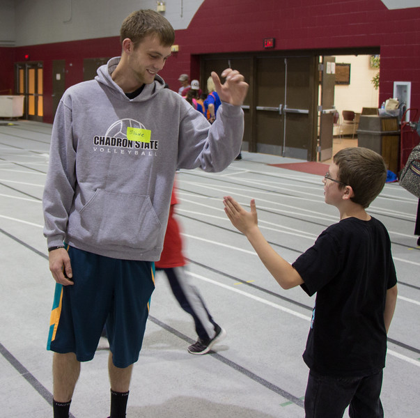 Slade Hunn of Chadron, Nebraska, interacts with elementary students during the Kids Fitness and Nutrtion Day, Oct. 25, 2016. (Photo by Conor Casey/CSC)