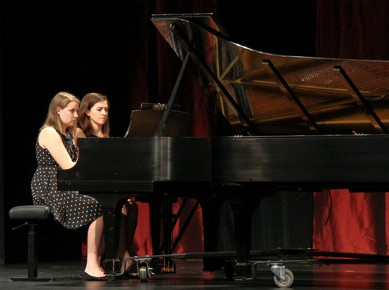 Jayne Barrow, left, and Talia Enevoldsen perform a musical piece at the spring Keyboard Ensemble in Memorial Hall. (Photo by Conor Casey/CSC)