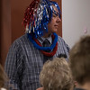 """Dr. Pat Beu, senior director of student affairs, gets into the spirit of the """"Going Out with a Bang"""" year-end ceremony in the King Library's Learning Center Tuesday, May 3, 2016, to honor Chadron State College tutors and Supplemental Instruction leaders. (Photo by Tena L. Cook/Chadron State College)"""