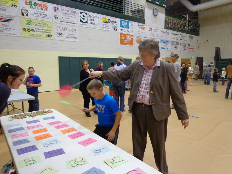 Dr. Beth Wentworth, professor of math at Chadron State College, right, plays a game with Jaron Dahlgren at the Hay Springs Family Math Night in November 2016. (Courtesy photo)