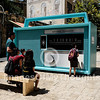 People interact with a giant radio receiver in Jerusalem's downtown