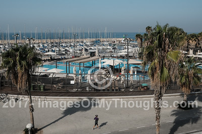 A view of the Tel Aviv marina and Gordon Pool at Gordon Beach in Tel Aviv