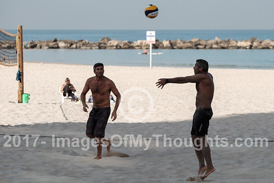 Men enjoy a game of volley ball at Gordon Beach in Tel Aviv
