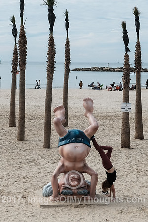 A statue depicts David Ben Gurion, Israel's first prime minister, doing a headstand along the Tel Aviv Mediterranean beach front.