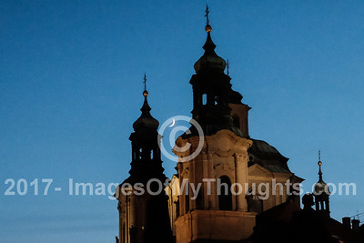 Moonrise over St. Nicholas' Church in Stare Mesto, Old Town Prague.