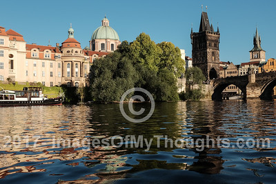 A view of the Charles Bridge, Karluv Most, from within a boat sailing in the Vltava River.