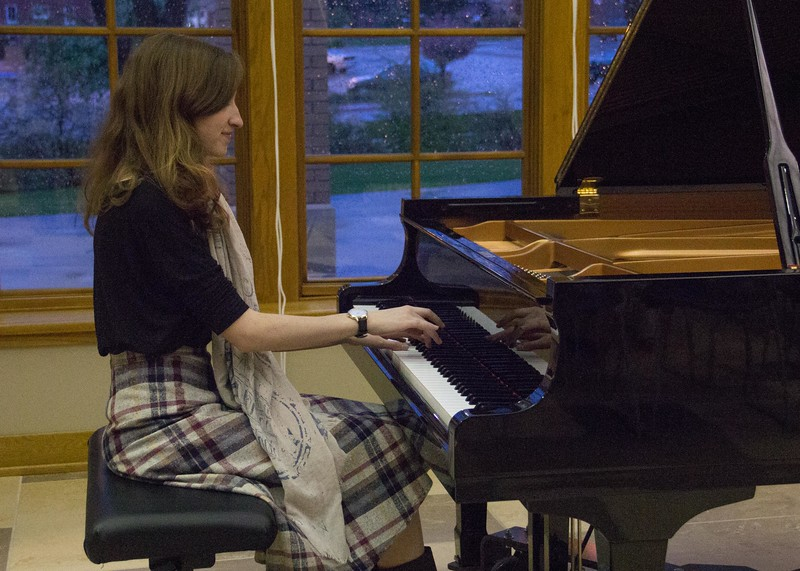 Chadron State College music major Donica Enevoldsen performs at the Piano Studio Recital Thursday, April 27, 2017, in the Sandoz Center Chicoine Atrium. (Photo by Tena L. Cook/Chadron State College)