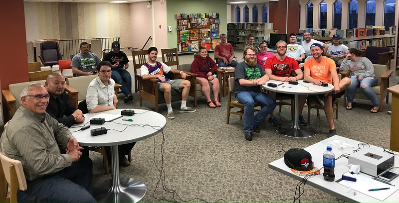 Eleven teams competed in the fifth annual Blue Key Brain Bowl Thursday, April 13, 2017, at the King Library. Following the trivia competition, students and faculty posed for a photo together. The winning team, right, consisted of Coy Clark, Alex Coon and Taylor Osmotherly. Following the students' victory, faculty members, left, Dr. Rick Koza, Dr. Jamie Wada and Dr. Steve Coughlin challenged them to a friendly game of trivia. (Photo by Sam Parker)